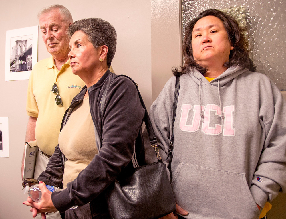 Description of . Relatives of hit-and-run fatality victim Aguida Luna meet with the news media at the CHP Baldwin Park Station to ask for public help in finding the driver of a 1994-1997 Acura Integra that may have been involved in the Nov. 27, 2013 accident on Citrus Avenue in incorporated Azusa.  Luna's sister Carla Azerz, right, with in-laws Felicidad and Robert McIntosh Dec. 4, 2013.  (Staff photo by Leo Jarzomb/San Gabriel Valley Tribune)