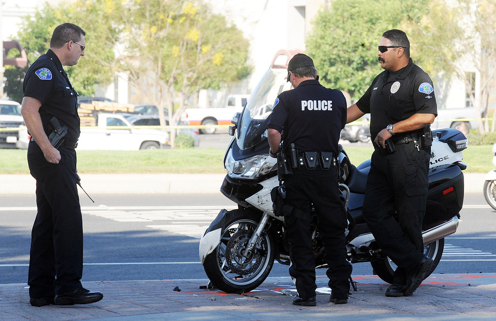 Description of . An Ontario police department motorcycle officer was airlifted to an unknown hospital in serious condition after colliding with a big rig on Archibald Avenue south of Philadelphia Street Tuesday morning October 8, 2013 at approximately 7:10 a.m. The cause of the accident is currently under investigation. (Will Lester/Inland Valley Daily Bulletin)