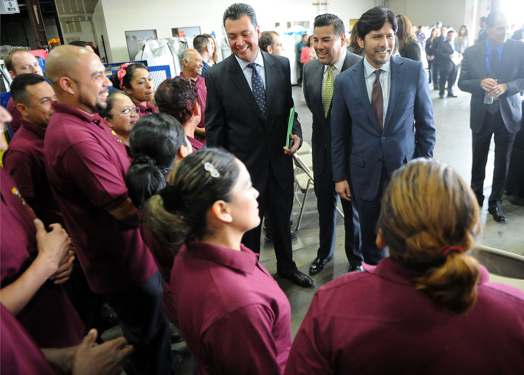 Description of . Sen. Alex Padilla, left, along with D-Pacoima along with Senator Kevin de Leon, right, D-Los Angeles and Senator Ricardo Lara, center, D-Huntington Park/ Long Beach greet employees prior to announcing the support for legislation to ban single use plastic bags during a press conference at Command Packaging in Vernon, Calif., on Friday, Jan. 24, 2014. (Keith Birmingham Pasadena Star-News)
