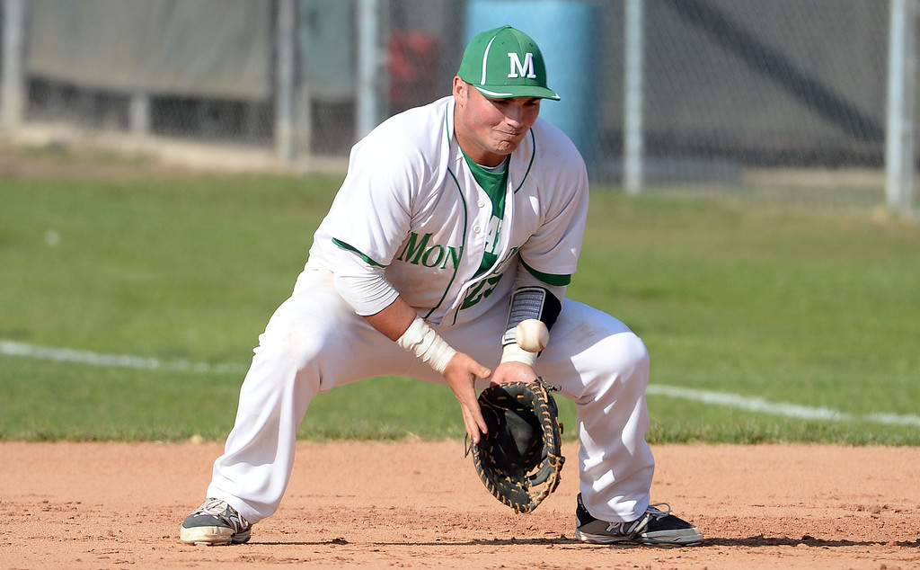 Description of . Monrovia first baseman Jason Daly fields a ground ball by Alhambra's Andrew Prieto (not pictured) in the fourth inning of the Arcadia Elk Baseball Tournament at Monrovia High School in Monrovia, Calif., on Thursday, March 13, 2014. Monrovia won 2-0.  (Keith Birmingham Pasadena Star-News)
