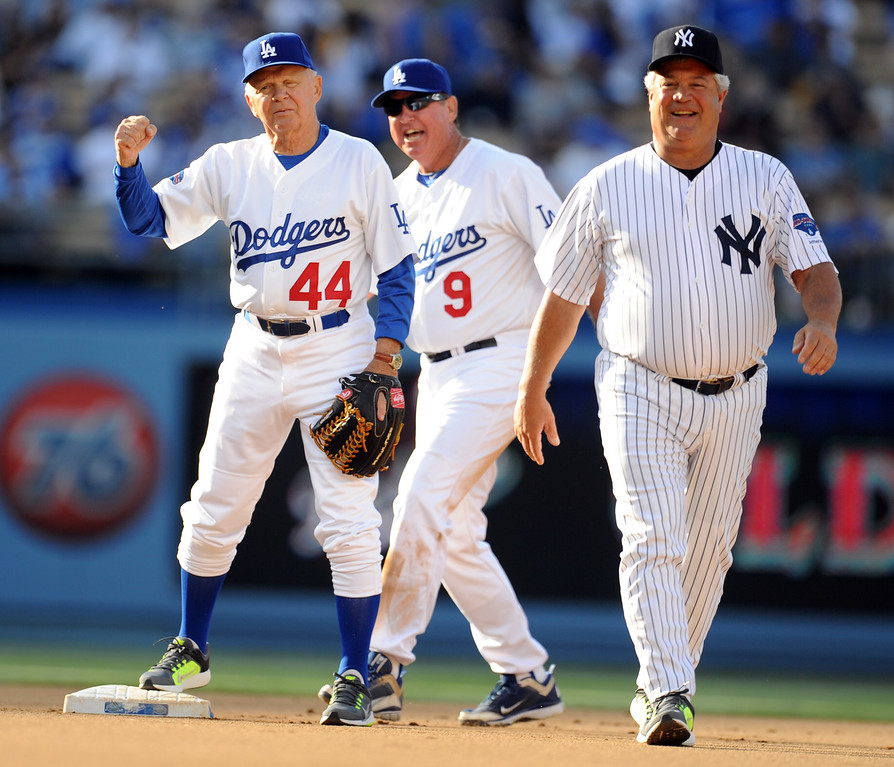 Description of . Former Los Angeles Dodgers Dick Tracewski (44) with Mickey Hatcher (9) and former New York Yankees Rick Cerone during the Old-Timers game prior to a baseball game between the Atlanta Braves and the Los Angeles Dodgers on Saturday, June 8, 2013 in Los Angeles.   (Keith Birmingham/Pasadena Star-News)