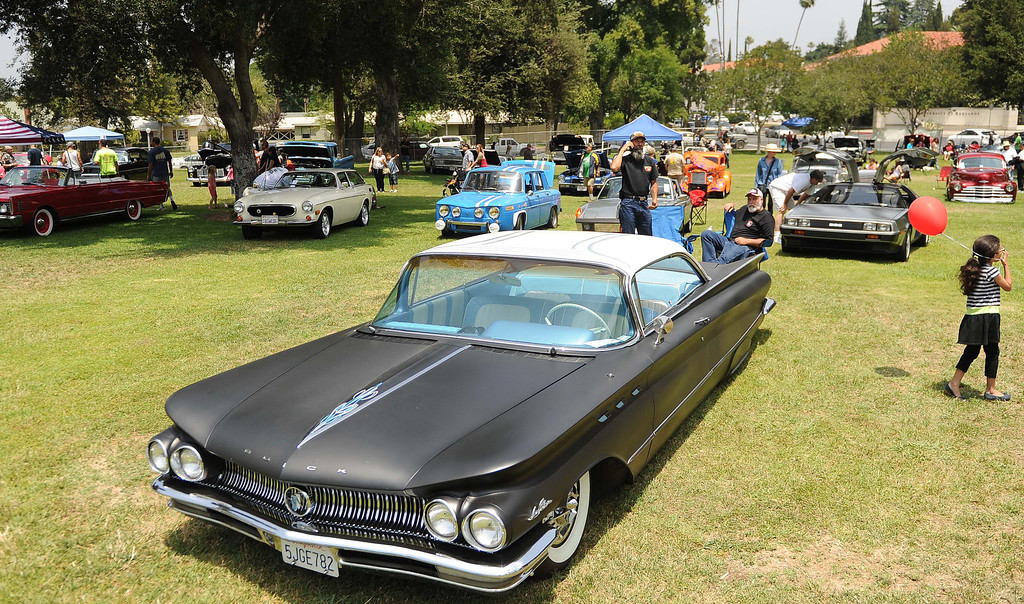Description of . The 22nd annual Optimist Car Show was held at Sylvan Park Saturday May 18, 1013 in Redlands. The event feature classic cars, a chili cook-off, food trucks, a beer garden and more. Proceeds will benefit the non-profit organization and its community projects. LaFonzo Carter/ Staff Photographer
