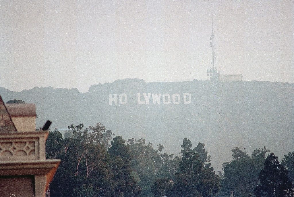 Description of . The famed, HOLLYWOOD sign reflected the anticipated arrival in Los Angeles, of Pope John Paul II, after pranksters altered the sign during the early morning hours to read, HOLYWOOD, seen in this Tuesday, Sept. 15, 1987, file photo. (AP Photo)