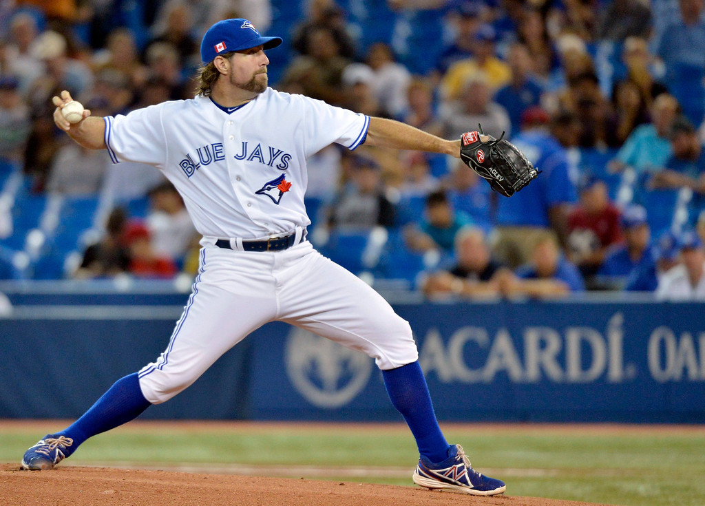 Description of . Toronto Blue Jays starting pitcher R.A. Dickey throws against the Los Angeles Angels during first-inning AL baseball game action in Toronto, Wednesday, Sept. 11, 2013. (AP Photo/The Canadian Press, Nathan Denette)