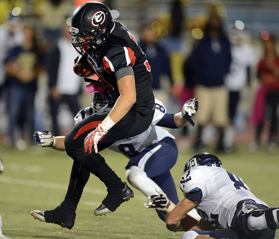 Description of . Glendora's Amin Raad runs for a first down as Los Osos' Tyler Lyon (8) tackles in the first half of a prep football game at Citrus College in Glendora, Calif., on Thursday, Oct. 31, 2013.    (Keith Birmingham Pasadena Star-News)