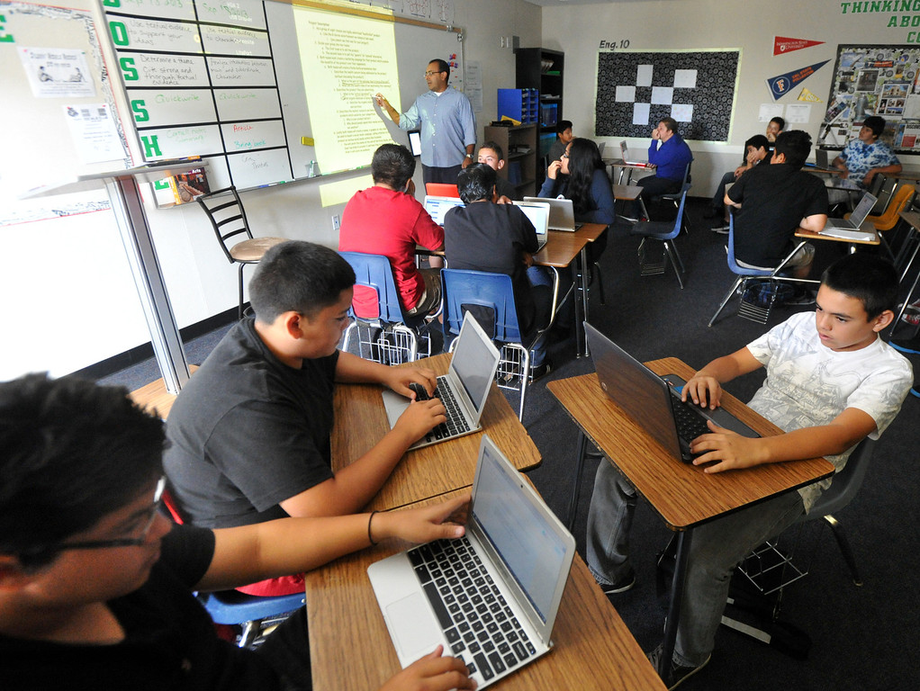 Description of . Students listen to biology teacher Miguel Espinoza as they work with their laptops as part of the CORE program at Nogales High School in Rowland Heights on Wednesday September 18, 2013. CORE, the Creation Of Revolutionary Education, is a program that provides a small learning community centered around Technology, Science and English. (San Gabriel Valley Tribune/Staff Photo by Keith Durflinger)