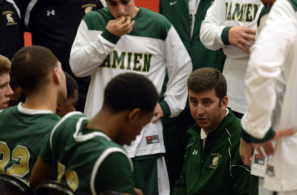 Description of . Damien head coach Matt Dunn during a time-out against Walnut in the first half of the Glendora basketball tournament at Glendora High School in Glendora, Calif., on Friday, Dec. 13, 2013. Damien won 66-60.  (Keith Birmingham Pasadena Star-News)