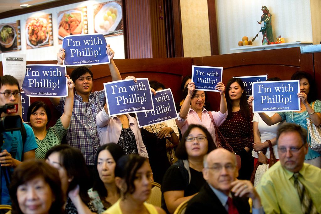 Description of . Phillip Chen's campaign supporters hold up signs during his announcement in his run for 55th State Assembly District at Seafood Village Restaurant in Rowland Heights on Thursday, July 8, 2013. The Walnut Valley school board member is running in the 55th Assembly district currently represented by Assemblyman Curt Hagman, who is not running for reelection due to term limits. (SGVN/Staff photo by Watchara Phomicinda)