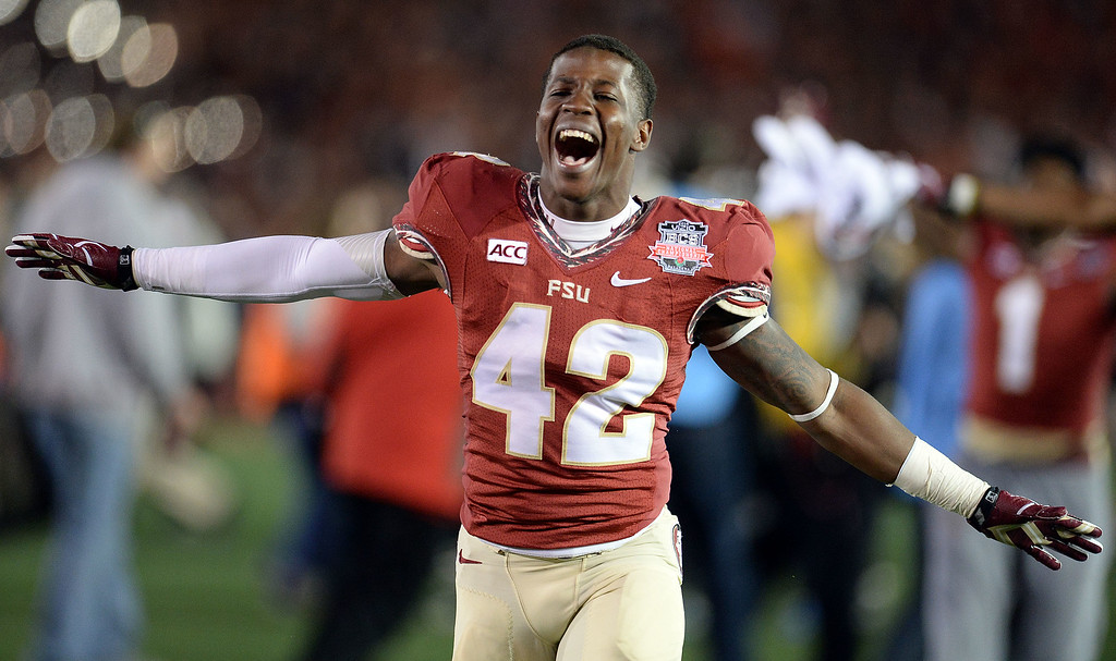 Description of . Florida State tight end Shayne Broxsie (42) reacts after defeating Auburn 34-31 during the BCS National Championship game at the Rose Bowl in Pasadena, Calif., on Monday, Jan. 6, 2014. 