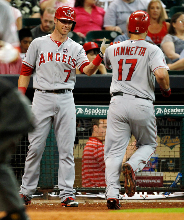 Description of . Los Angeles Angels Chris Iannetta, right, celebrates his solo home run with Andrew Romine in the third inning of a baseball game against the Houston Astros Saturday, Sept. 14, 2013 at Minute Maid Park in Houston. (AP Photo/Eric Christian Smith)
