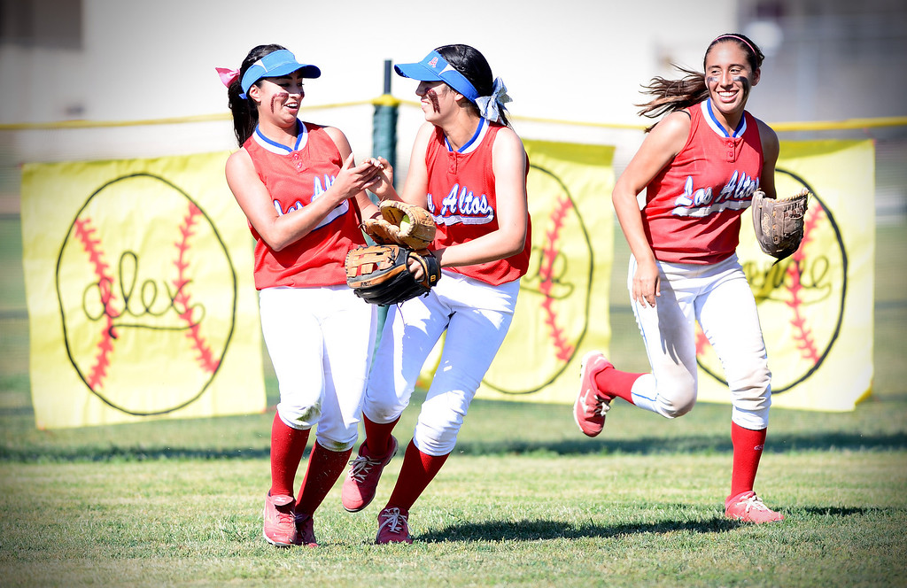 Description of . Los Altos celebrates with Nadine Barragan, left, after she dove for a ball as they defeated West Covina 4-3 Thursday, May 15, 2014 at West Covina High School. (Photo by Sarah Reingewirtz/Pasadena Star-News)