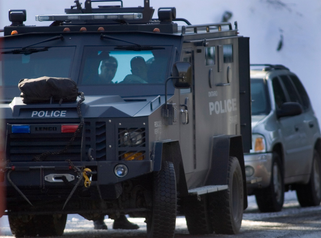 Description of . SWAT teams from all over the southland converged into the forest to assist in the capture of wanted fugitive Christopher Jordan Dorner.