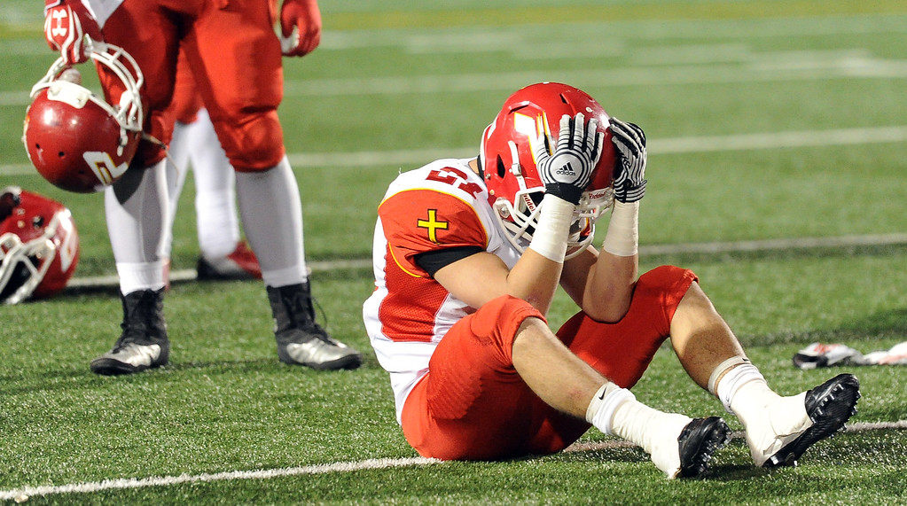 Description of . Paraclete's Franky Ramirez (21) hold his head after losing to San Dimas 20-14 a CIF-SS Mid-Valley Division championship football game at San Dimas High School in San Dimas, Calif., on Friday, Dec. 6, 2013.   (Keith Birmingham Pasadena Star-News)