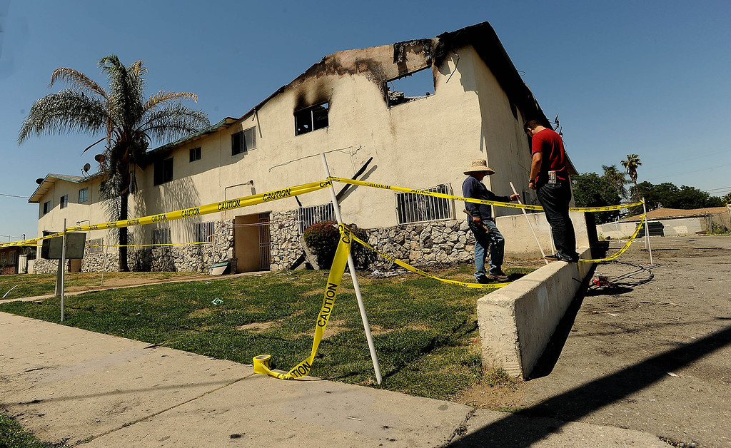 Description of . A view of fire damage at an apartment complex along the 7200 block of Elm Street in Highland May 13, 2013. GABRIEL LUIS ACOSTA/STAFF PHOTOGRAPHER.