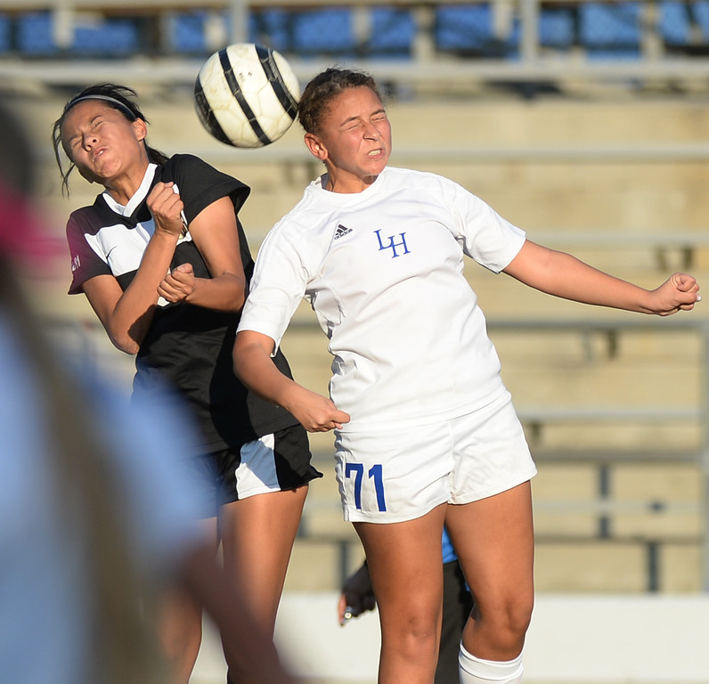 Description of . La Habra's Samiya Washington (#71) leaps for a headshot as they play Sunny Hills in their girls soccer game at La Habra High School on Thursday January 16, 2014. Sunny Hills defeated La Habra 2-0. (Staff Photo by Keith Durflinger/San Gabriel Valley Tribune)
