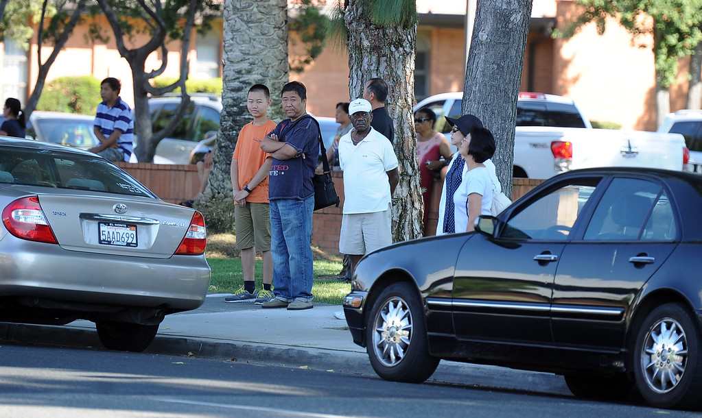 Description of . Parents wait in a church parking lot for word on their children after a lockdown at Arcadia High School in Arcadia, Calif. on Thursday, Sept. 12, 2013.   (Photo by Keith Birmingham/Pasadena Star-News)