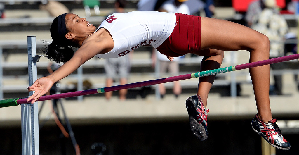 Description of . Long Beach Wilson's Kaelin Davis competes in the high jump during the CIF-SS Masters Track and Field meet at Falcon Field on the campus of Cerritos College in Norwalk, Calif., on Friday, May 30, 2014.   (Keith Birmingham/Pasadena Star-News)