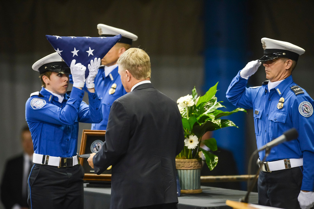 Description of . TSA officers present Acting Secretary of U.S. Homeland Security, Ran Beers with the flag for slain TSA officer Gerardo Hernandez at the Los Angeles Sports Arena Tuesday, November 12, 2013.  A public memorial was held for Officer Hernandez who was killed at LAX when a gunman entered terminal 3 and opened fire with a semi-automatic rifle.  ( Photo by David Crane/Los Angeles Daily News )