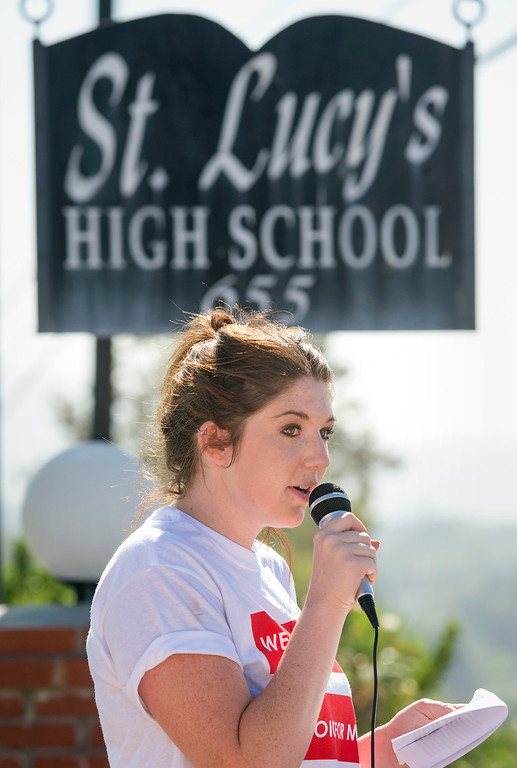 Description of . St. Lucy's Priory High School alum Abigail O'Brien speaks during a protest opposing the dismissal of longtime teacher Ken Bencomo at the Glendora, Calif. campus August 8, 2013.  Bencomo was  terminated from the all-girls private parochial school after a photo of his marriage to his same-sex partner was published in a local newspaper.  (SGVN/Staff photo by Leo Jarzomb)