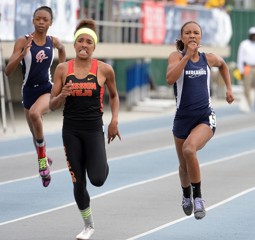 Description of . Redland's Margaux Jones, right, finishes second in the division 2 200 meters race during the CIF Southern Section track and final Championships at Cerritos College in Norwalk, Calif., Saturday, May 24, 2014. 