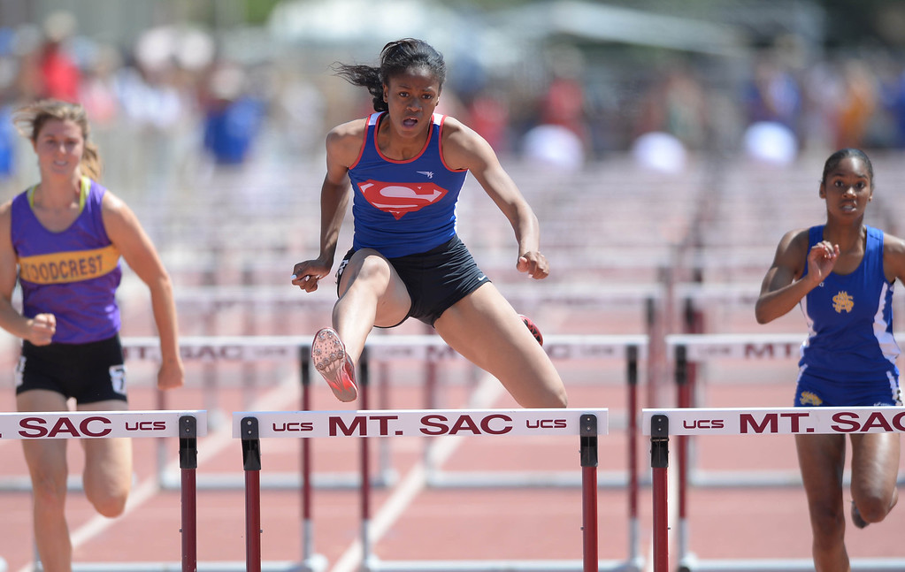 Description of . Serra's Megan George wins the 100 meter Division 4 high hurdles race of the CIF Southern Section Track and Field Championships Saturday at Mt. SAC. 20130518 Photo by Steve McCrank / Staff Photographer