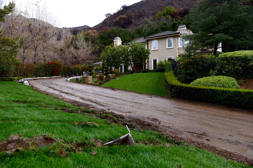 Description of . Homes in the Easley Estates in Glendora had mudflow that came through their property seen Saturday morning, March 1, 2014. The homes sit below the Colby Fire burn area.  (Photo by Sarah Reingewirtz/Pasadena Star-News)