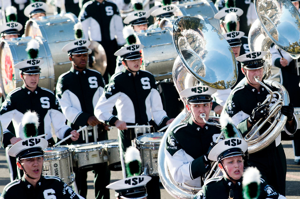 Description of . Michigan State University Spartan Marching band perform during 2014 Rose Parade in Pasadena, Calif. on January 1, 2014. (Staff photo by Leo Jarzomb/ Pasadena Star-News)