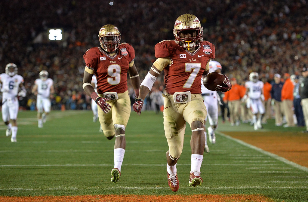 Description of . Florida State's Levonte Whitfield returns a fourth-quarter kickoff for a touchdown against Auburn the BCS national championship game at the Rose Bowl, Monday, January 6, 2014. (Photo by Michael Owen Baker/L.A. Daily News)