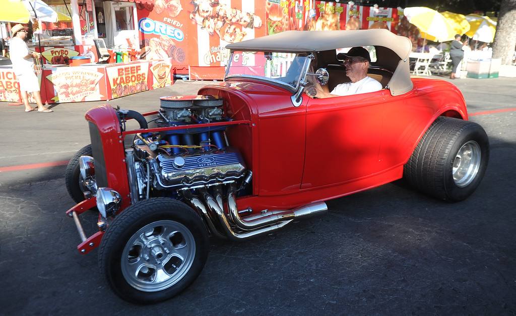 Description of . A classic car during the Diamond Bar community parade during the 91st Annual L.A. County Fair in Pomona, Calif. on Thursday, Sept. 5, 2013.   (Photo by Keith Birmingham/Pasadena Star-News)