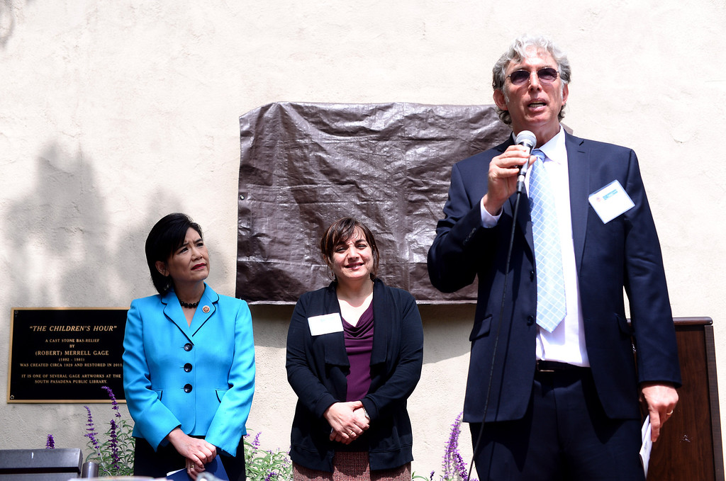 "Description of . Steve Jeldsted, director of South Pasadena Public Library, speaks before the unveiling of Merrell Gage's recently restored 1930 bas relief masterpiece, ""The Children's Hour"" by Congresswoman Judy Chu and South Pasadena Mayor Marina Khubesrian at South Pasadena Public Library Friday, March 21, 2014. The 600 lb. stone casting survived fire, breakage, and being buried until it was deemed to possess great local and national significance. (Photo by Sarah Reingewirtz/Pasadena Star-News)"