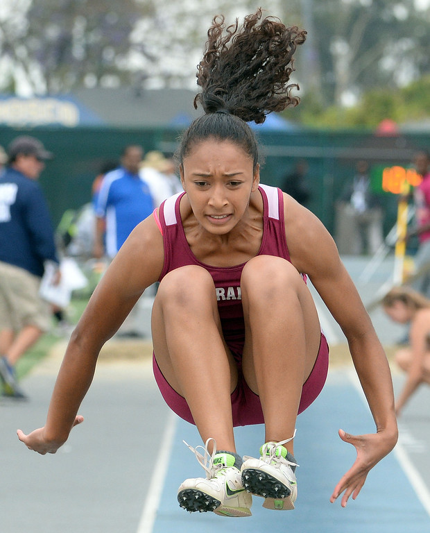 Description of . Torrance's Tyra Jackson competes in the Division 2 long jump during the CIF Southern Section track and final Championships at Cerritos College in Norwalk, Calif., Saturday, May 24, 2014. 