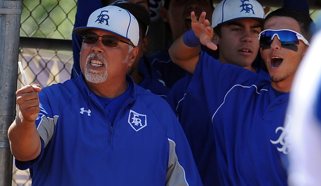 Description of . El Ranchohead coach Frank Llanes reacts in the sixth inning of a CIF-SS semifinal prep playoff baseball game against Baldwin Park at Baldwin Park High School on Tuesday, May 28, 2013 in Baldwin Park, Calif.  El Rancho won 5-4.  (Keith Birmingham/Pasadena Star-News)