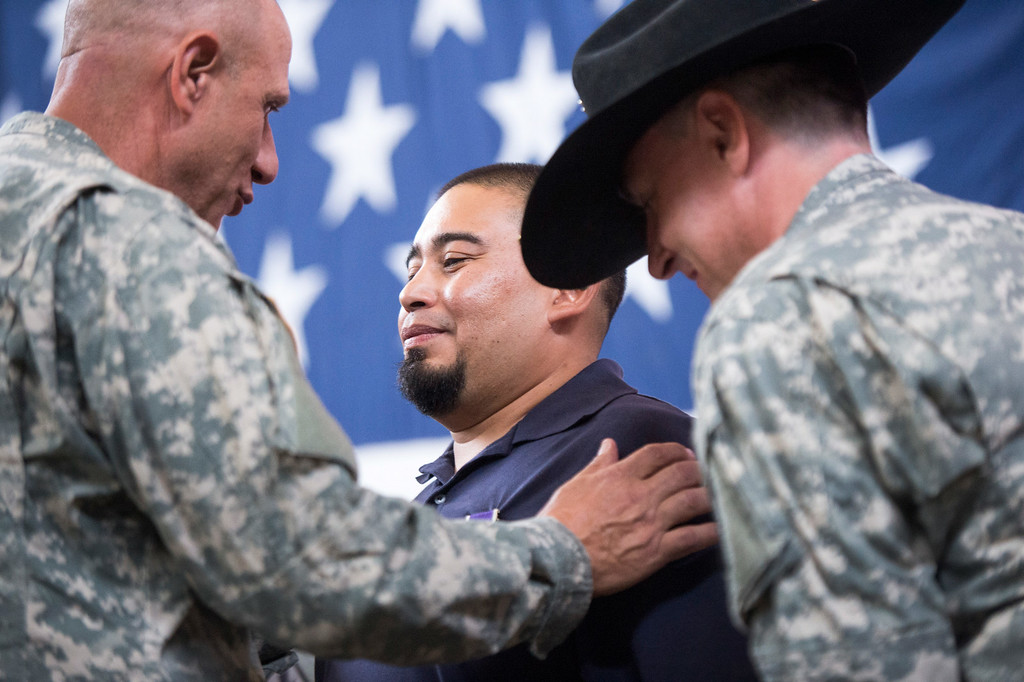 Description of . Sgt. Luis Bardales, a resident of Irwindale who works for the city of South Pasadena, receives a Purple Heart at the Army National Guard in Azusa Saturday, July 12, 2014. Bardales was wounded by a roadside IED in Baghdad, Iraq and saved gunner Gabriel Herrera by pulling him out of their Humvee before another IED explosion. (Photo by Sarah Reingewirtz/Pasadena Star-News)