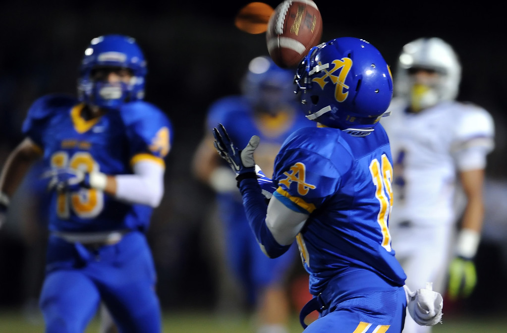 Description of . Bishop Amat's Trevon Sidney (18) intercepts a Charter Oak pass in the first half of a prep football game at Bishop Amat High School in La Puente, Calif. on Friday, Sept. 20, 2013.    (Photo by Keith Birmingham/Pasadena Star-News)