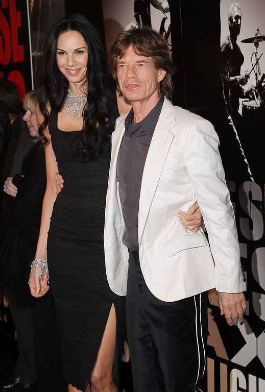 Description of . Musician Mick Jagger of the Rolling Stones and L'Wren Scott arrive at the premiere of 'Shine A Light' at the Ziegfeld Theater March 30, 2008 in New York City.  (Photo by Scott Gries/Getty Images)