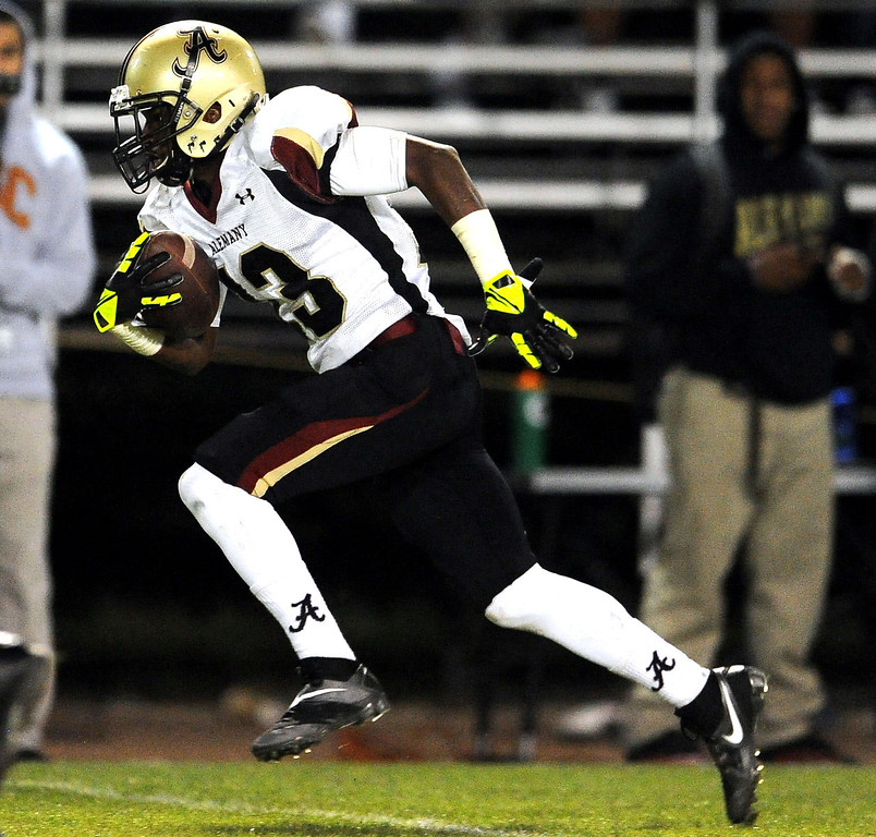 Description of . Alemany's Desean Holmes catches a pass for a 65 yard touchdown against Bishop Amat in the first half of a prep football game at Bishop Amat High School in La Puente, Calif., on Friday, Oct. 25, 2013.    (Keith Birmingham Pasadena Star-News)