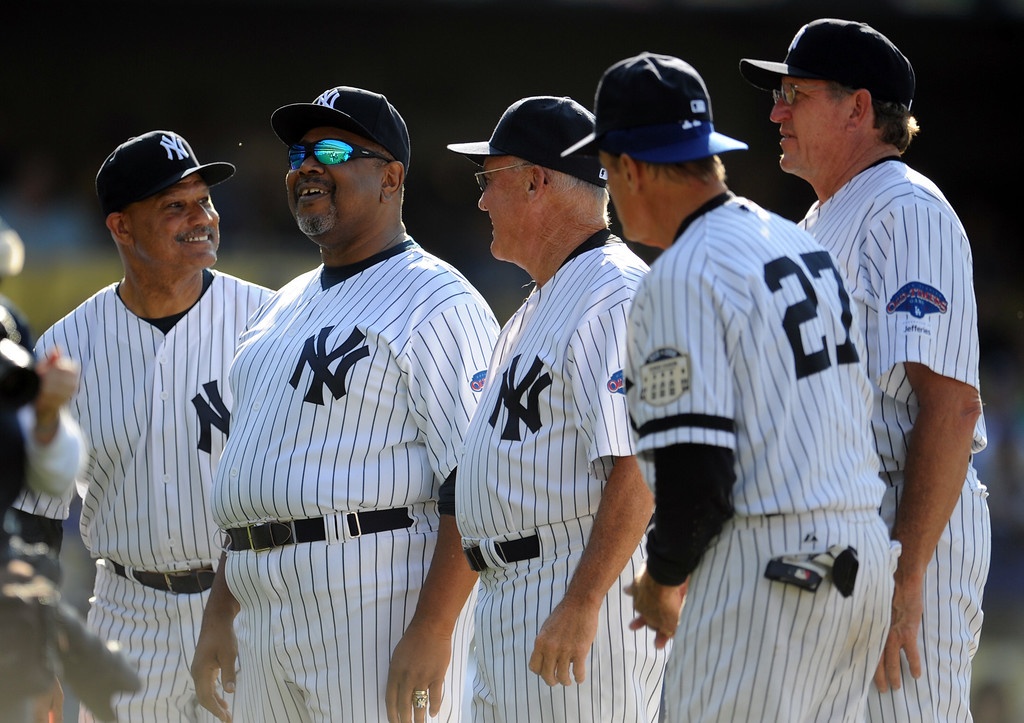 Description of . Former New York Yankees Chris Chambliss, left, with Bob Watson and teammates during the Old-Timers game prior to a baseball game between the Atlanta Braves and the Los Angeles Dodgers on Saturday, June 8, 2013 in Los Angeles.   (Keith Birmingham/Pasadena Star-News)