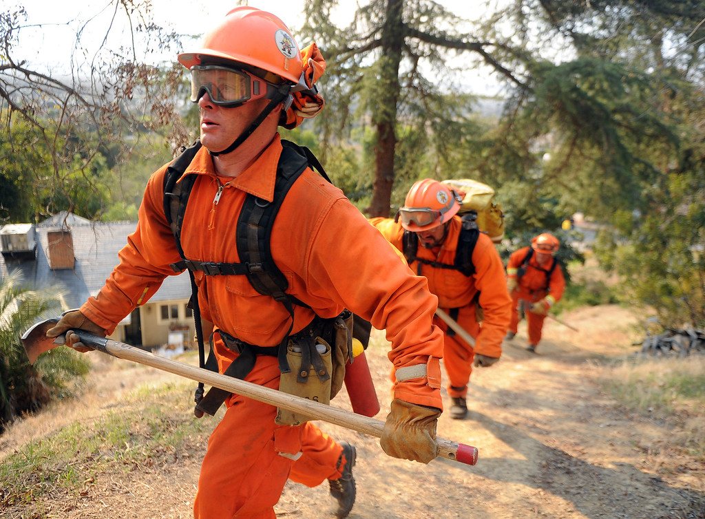 Description of . Cal Fire Helitac crew out of Chino along with various camp crews fight the Colby Fire, a1,700-acre plus brush fire that ignited in the Angeles National Forest north of Glendora along Yucca Ridge Rd. and Hicrest Rd. threatening homes and prompting mandatory evacuations in Glendora, Calif., on Thursday, Jan. 16, 2014. (Keith Birmingham Pasadena Star-News)