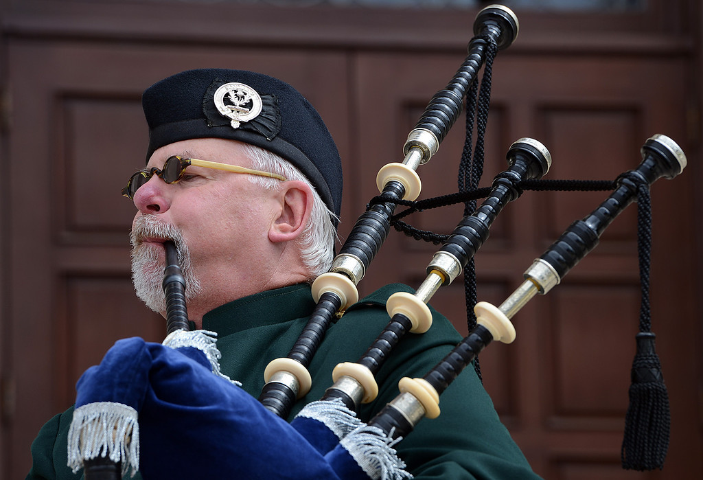 Description of . Richard Cook, of Tustin, plays Amazing Grace on the Scottish Bagpipes during a memorial service for fallen service members was held Friday May 17, 2013 in front of the Memorial Chapel at the university. The ceremony featured a special tribute to Keith Taylor, a University of Redlands alumnus and father of a University of Redlands student. He was killed serving in Iraq. (Rick Sforza/Staff photographer, Redlands Daily Facts)