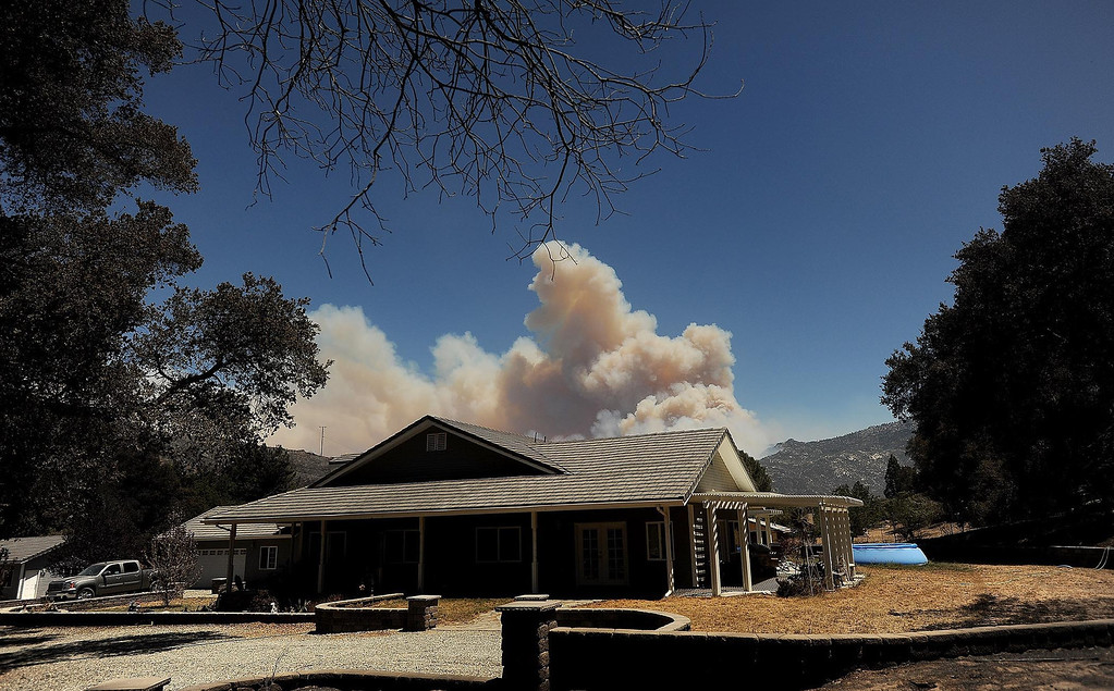 Description of . The plume of the Silver Fire remains visible from the Goble residence along Twin Pines Road in the mountains south of Banning August 8, 2013.   GABRIEL LUIS ACOSTA/STAFF PHOTOGRAPHER.