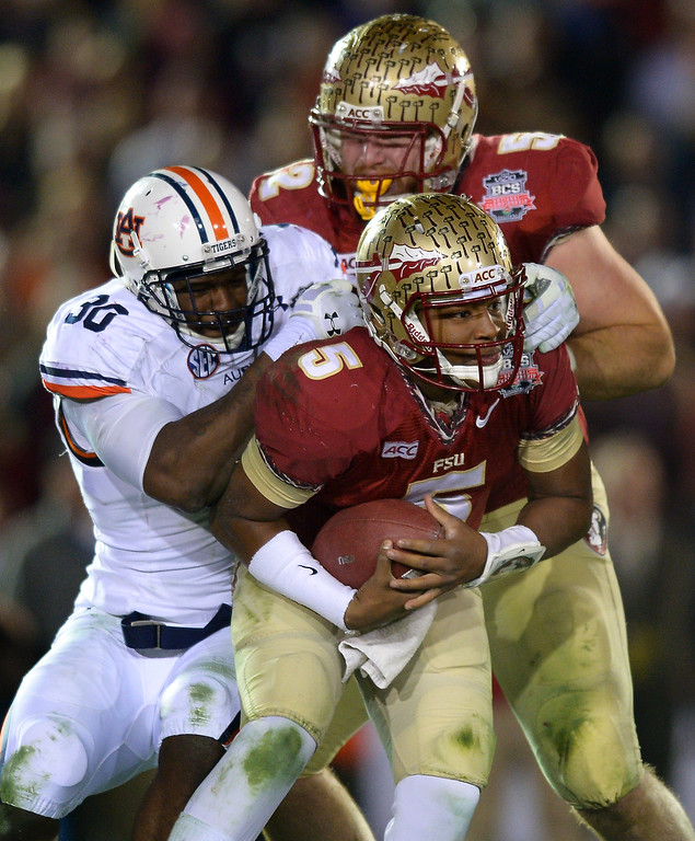 Description of . Auburn's Dee Ford sacks Florida State QB Jameis Winston in the second half of the BCS national championship game at the Rose Bowl, Monday, January 6, 2014. (Photo by Michael Owen Baker/L.A. Daily News)