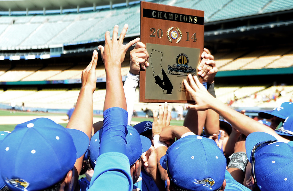 Description of . Bishop Amat holds up the championship trophy after defeating Palm Desert 4-3 to win the CIF-SS Division 3 baseball championship at Dodger Stadium in Los Angeles on Friday, June 6, 2014.   (Keith Birmingham/Pasadena Star-News)