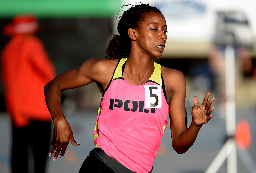 Description of . Long Beach Poly's Kaelin Roberts competes in the 400 meter dash during the CIF-SS Masters Track and Field meet at Falcon Field on the campus of Cerritos College in Norwalk, Calif., on Friday, May 30, 2014.   (Keith Birmingham/Pasadena Star-News)
