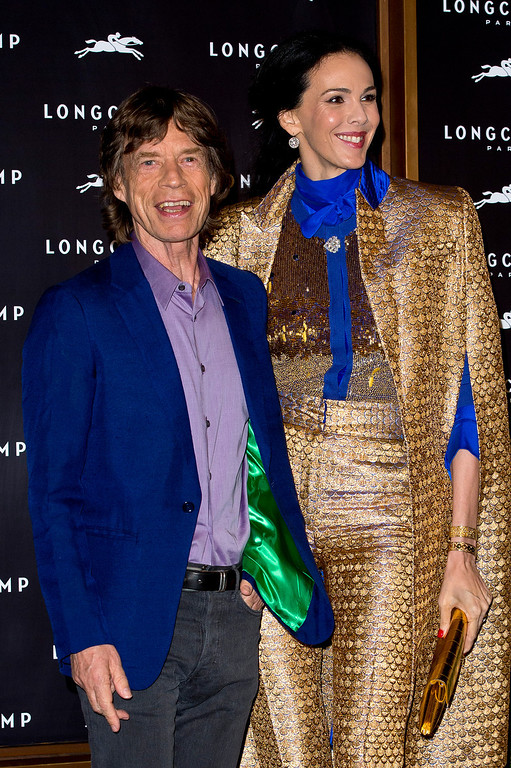 Description of . (L-R) L'Wren Scott and Mick Jagger attend the grand opening party of Longchamp Regent Street on September 14, 2013 in London, England.  (Photo by Ben A. Pruchnie/Getty Images)