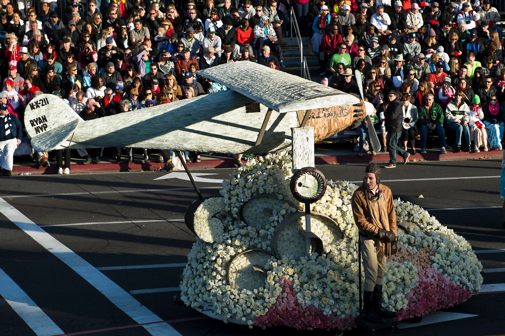 Description of . Charles Linbergh's first transatlantic flight in the Spirit of St. Louis with Wells Fargo's Opening Show during 2014 Rose Parade in Pasadena, Calif. on January 1, 2014. (Staff photo by Leo Jarzomb/ Pasadena Star-News)