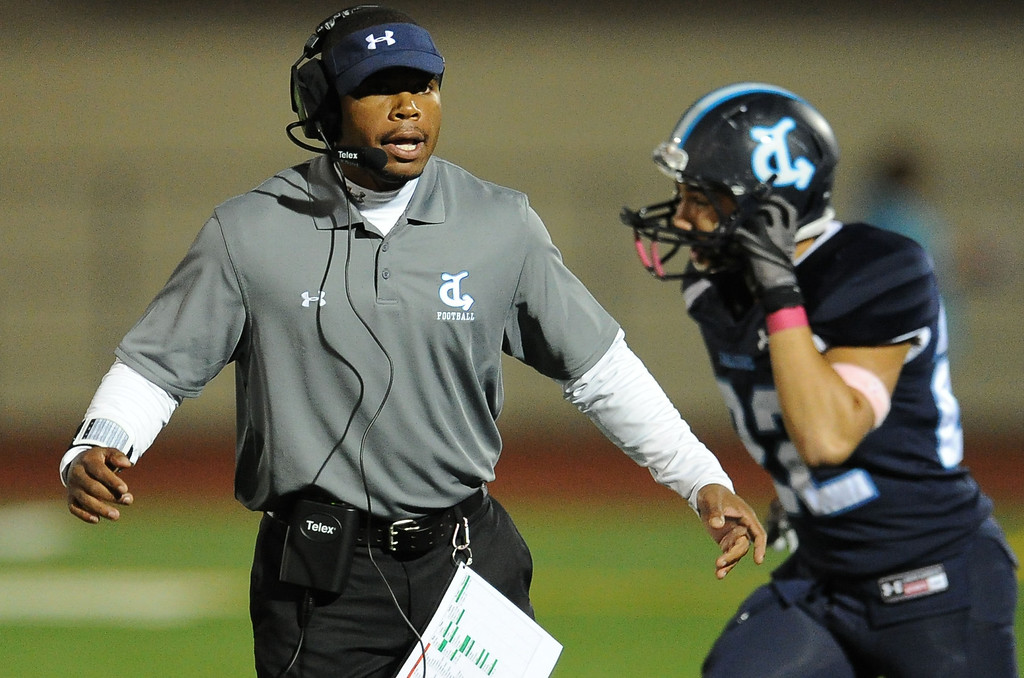 Description of . Duarte head coach Jason Martin in the first half of a prep football game against Gladstone at Duarte High School in Duarte, Calif., Thursday, Oct. 10, 2013.    (Keith Birmingham Pasadena Star-News)
