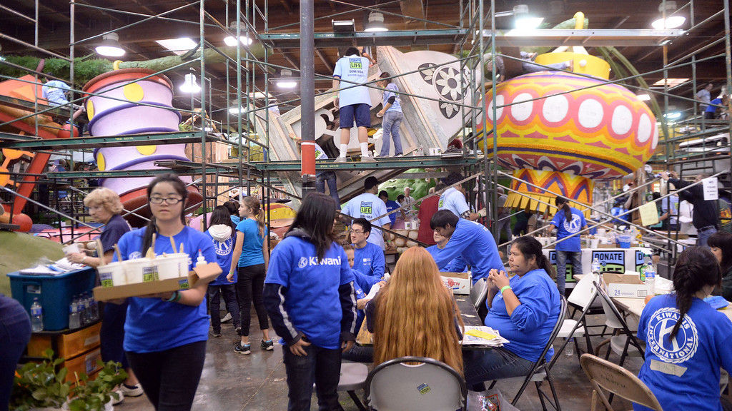 Description of . Kiwanis workers during the final stages of preparation for the 2014 Rose Parade as a variety of seeds, bark, fruits and vegetables, grasses and of course, flowers are being applied to the floats by experienced professionals as well as hard working volunteers at the Rosemont Pavilion in Pasadena, Calif., on Saturday, Dec. 28, 2013.     (Keith Birmingham Pasadena Star-News)