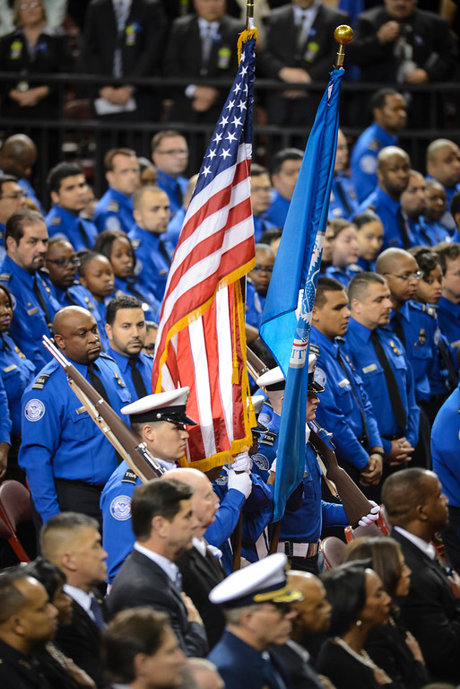 Description of . TSA officers bring in the flag for the memorial for slain TSA officer Gerardo Hernandez at the Los Angeles Sports Arena Tuesday, November 12, 2013.  A public memorial was held for Officer Hernandez who was killed at LAX when a gunman entered terminal 3 and opened fire with a semi-automatic rifle, Grigsby was wounded in the attack.  ( Photo by David Crane/Los Angeles Daily News )