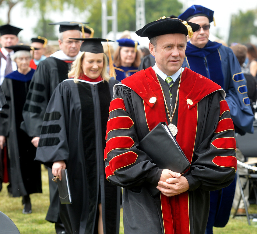 Description of . Dr. Barry Corey leads the procession during the Commencement Ceremony at Biola University in La Mirada on Friday May 23, 2014. Kay Warren, International speaker and author, gives the commencement address. (Photo by Keith Durflinger/Whittier Daily News)