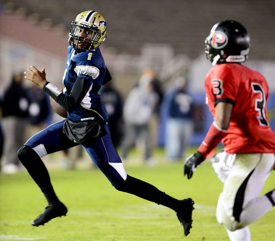 Description of . Muir's quarterback Dejon Williams (1) makes the last touchdown of the game in the annual Turkey Tussle against Pasadena Friday night, November 8, 2013 at the Rose Bowl in Pasadena as they defeat Pasadena 32-21.(Photo by Sarah Reingewirtz/Pasadena Star-News)